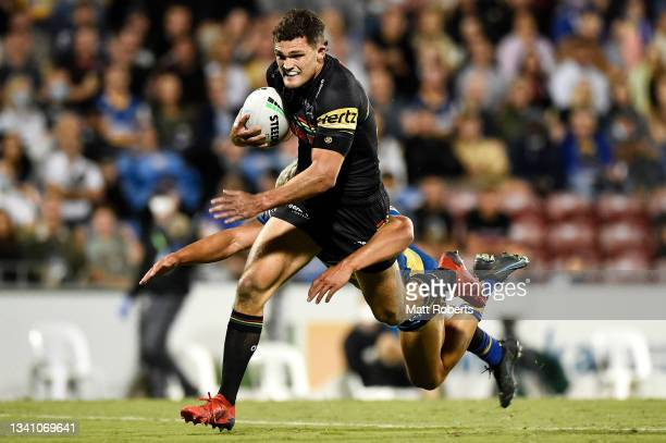 Nathan Cleary of the Panthers is tackled by Dylan Brown of the Eels during the NRL Semifinal match between the Penrith Panthers and the Parramatta...