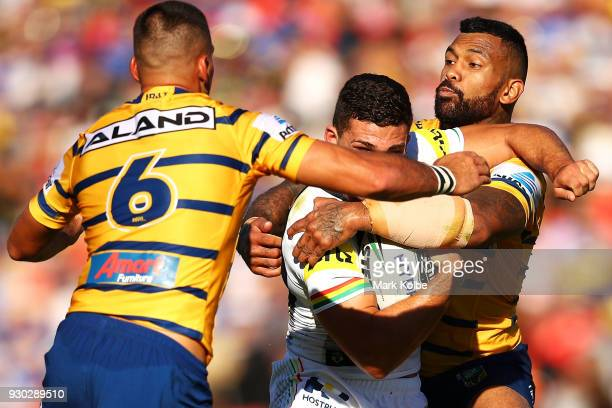 Nathan Cleary of the Panthers is tackled by Manu Ma'u of the Eels during the round one NRL match between the Penrith Panthers and the Parramatta Eels...