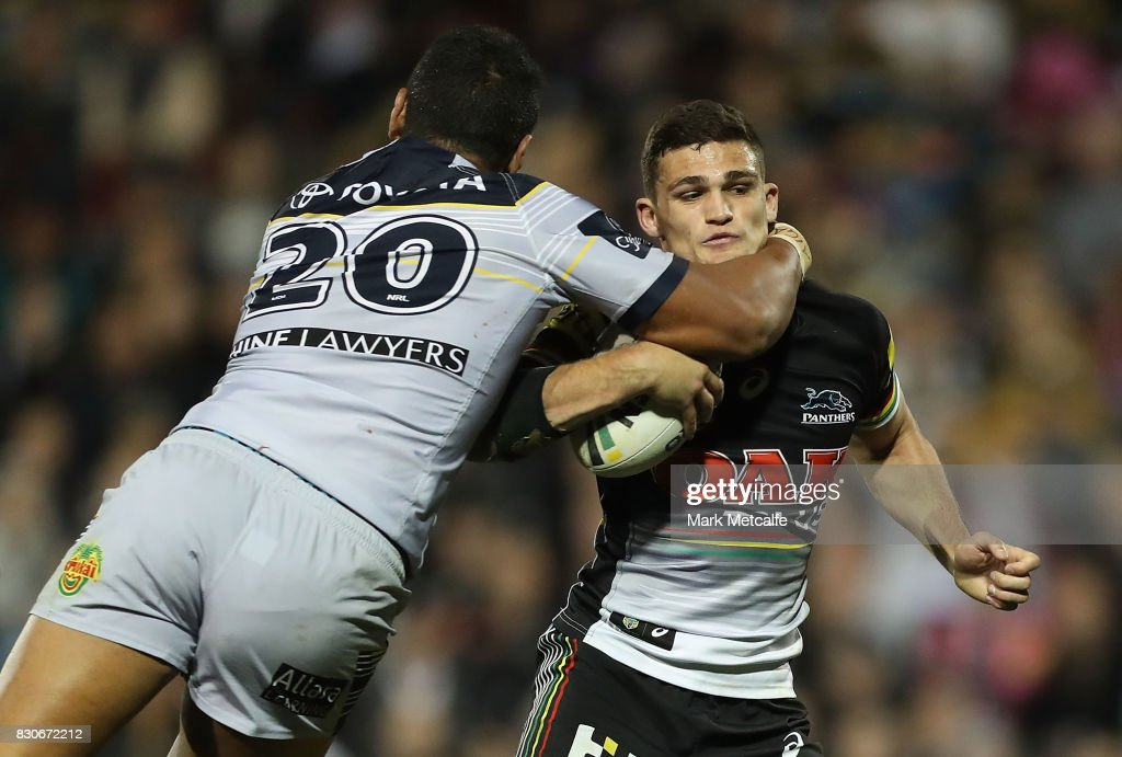 Nathan Cleary of the Panthers is tackled by Patrick Mago of the Cowboys during the round 23 NRL match between the Penrith Panthers and the North Queensland Cowboys at Pepper Stadium on August 12, 2017 in Sydney, Australia.