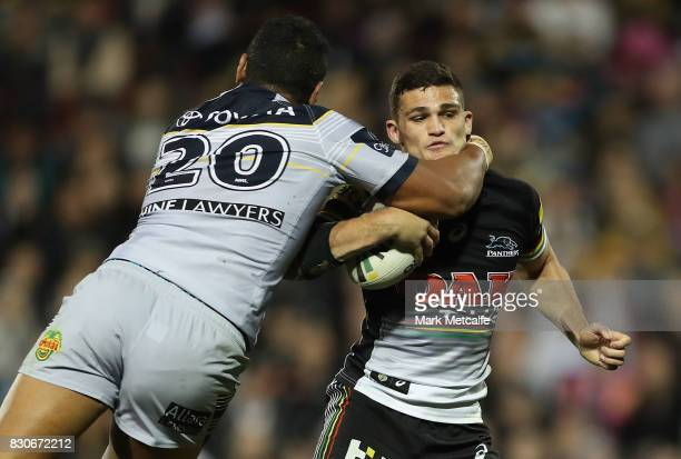 Nathan Cleary of the Panthers is tackled by Patrick Mago of the Cowboys during the round 23 NRL match between the Penrith Panthers and the North...