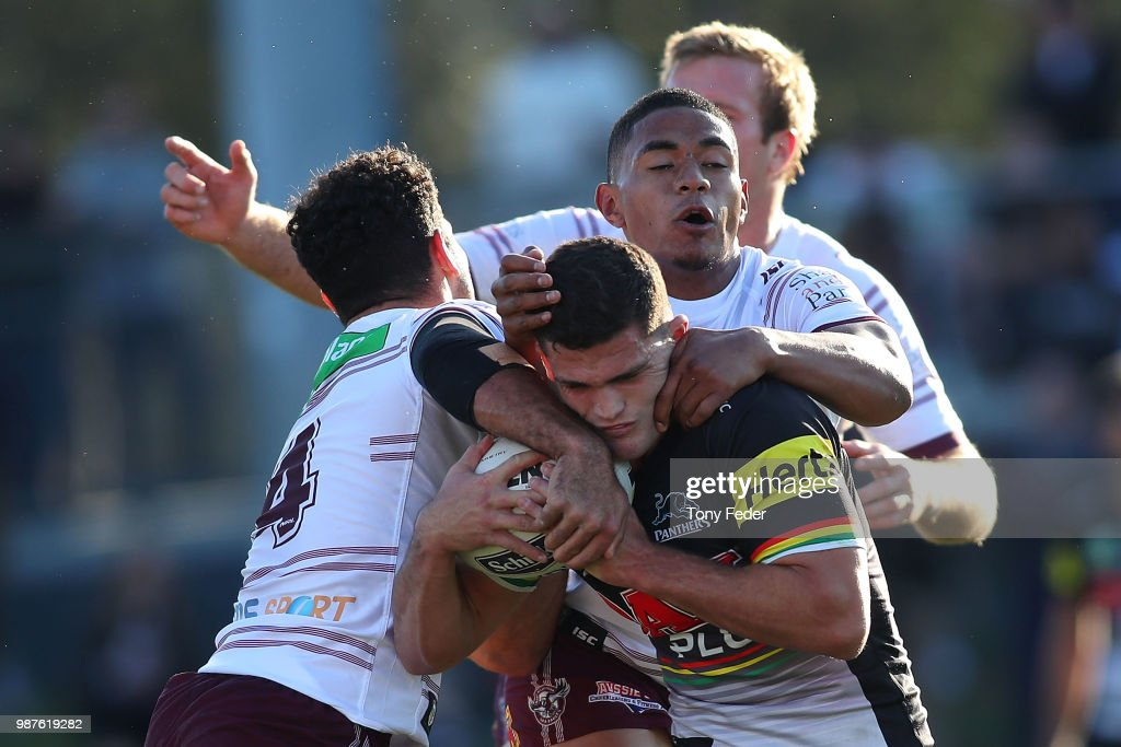 Nathan Cleary of the Panthers is tackled during the round 16 NRL match between the Penrith Panthers and the Manly Sea Eagles at Panthers Stadium on June 30, 2018 in Penrith, Australia.