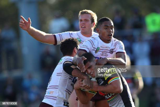 PENRITH AUSTRALIA JUNE Nathan Cleary of the Panthers is tackled during the round 16 NRL match between the Penrith Panthers and the Manly Sea Eagles...