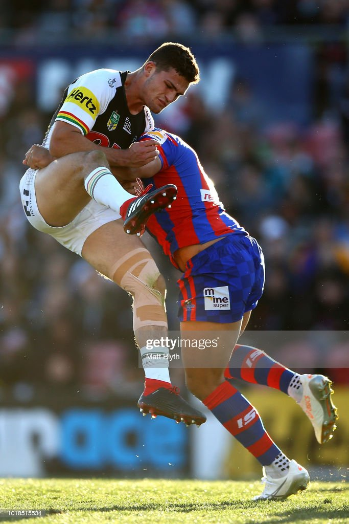 Nathan Cleary of the Panthers is tackled mid-air by Herman Ese'ese of the Knights during the round 23 NRL match between the Penrith Panthers and the Newcastle Knights at Panthers Stadium on August 18, 2018 in Sydney, Australia.