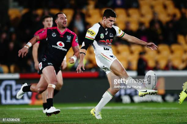 Nathan Cleary of the Panthers kicks the ball against Bodene Thompson of the Warriors during the round 19 NRL match between the New Zealand Warriors...