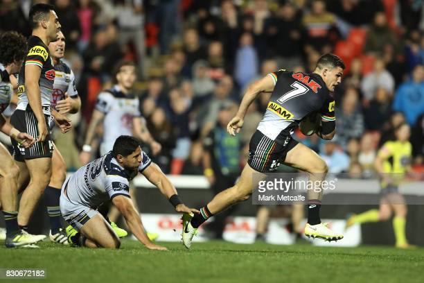 Nathan Cleary of the Panthers makes a break to score a try during the round 23 NRL match between the Penrith Panthers and the North Queensland...