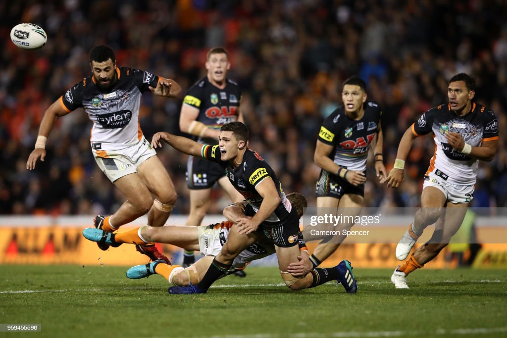 Nathan Cleary of the Panthers offloads the ball during the round 11 NRL match between the Penrith Panthers and the Wests Tigers at Panthers Stadium on May 17, 2018 in Penrith, Australia.