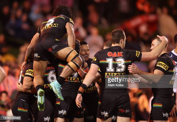 Nathan Cleary of the Penrith Panthers celebrates after scoring a try during the round 15 NRL match between the Penrith Panthers and the Sydney...