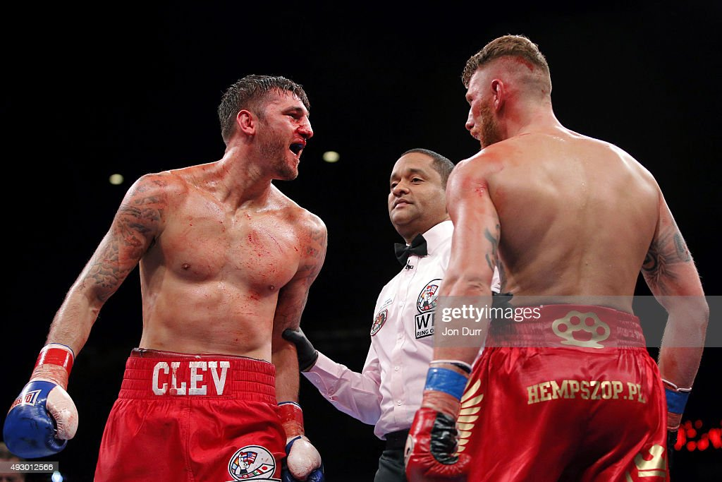 Nathan Cleverly (L) and Andrzej Fonfara react at the end of a round during their Main Event: Light Heavyweights fight at UIC Pavilion on October 16, 2015 in Chicago, Illinois. Andrzej Fonfara won by unanimous decision.