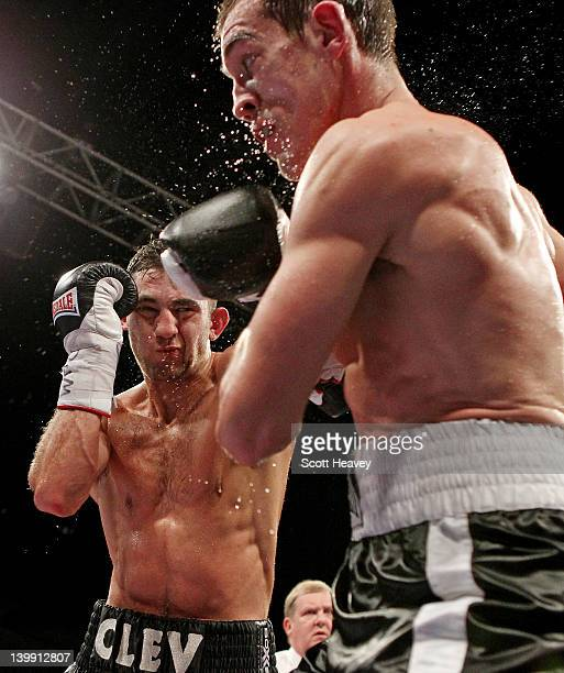 Nathan Cleverly in action with Tommy Karpency during the WBO Light-Heavyweight Championship bout at the Motorpoint Arena on February 25, 2012 in...