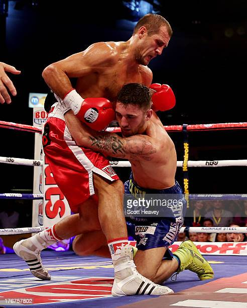Nathan Cleverly is knocked down by Sergey Kovalev during the WBO World Light-Heavyweight Championship bout at Motorpoint Arena on August 17, 2013 in...