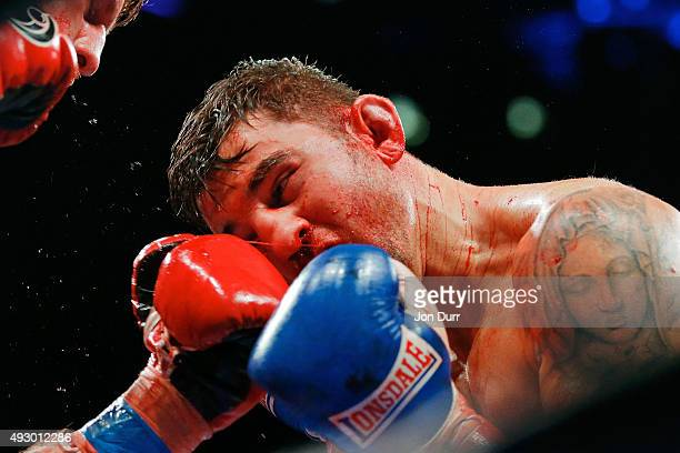 Nathan Cleverly is struck by Andrzej Fonfara during their Main Event: Light Heavyweights fight at UIC Pavilion on October 16, 2015 in Chicago,...