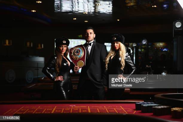 Nathan Cleverly the WBO World Light-Heavyweight title poses alongside two Russian deadly agents to promote his forthcoming fight against Sergey...