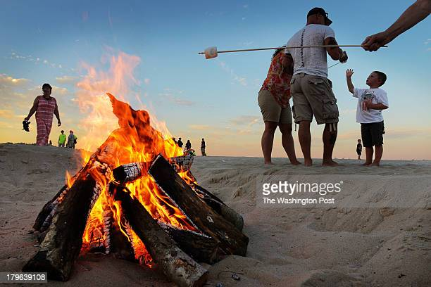 Nathan Condon waits for a freshly toasted marshmallow on the beach as residents open their resort homes to families of wounded warriors on September...