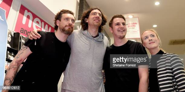 Nathan Connolly and Gary Lightbody of Snow Patrol during an instore signing and performance of their new album 'Wildness' at HMV Manchester on May 31...