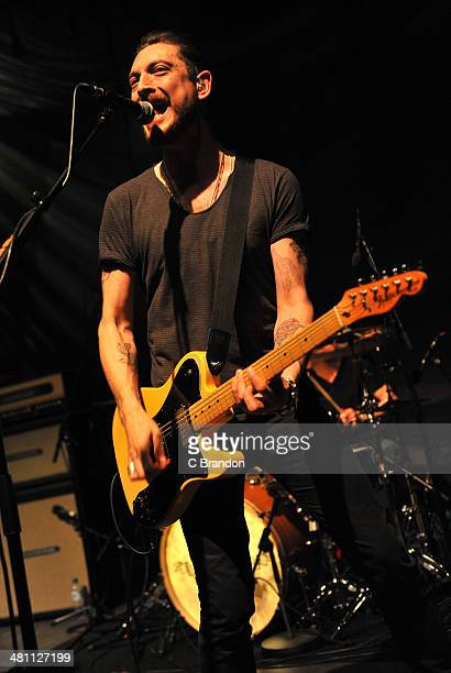 Nathan Connolly of Little Matador performs on stage at Shepherds Bush Empire on March 27 2014 in London United Kingdom
