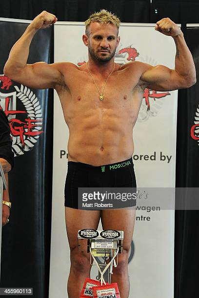 Nathan Corbett stands on the scales during the weighin ahead of Total Carnage IV at the Gold Coast Convention and Exhibition Centre on December 13...