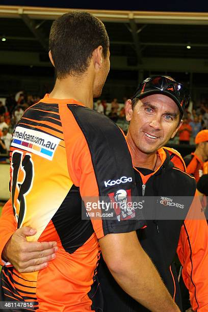 Nathan CoulterNile and coach Justin Langer of the Perth Scorchers celebrate after defeating the Hobart Hurricanes during the Big Bash League match...