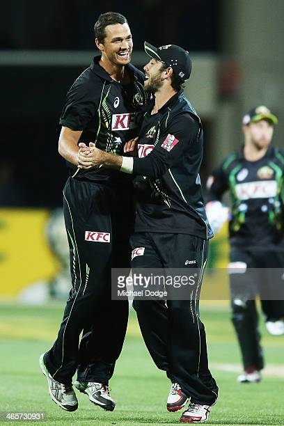Nathan CoulterNile celebrates a wicket with Glenn Maxwell during game one of the International Twenty20 series between Australia and England at...
