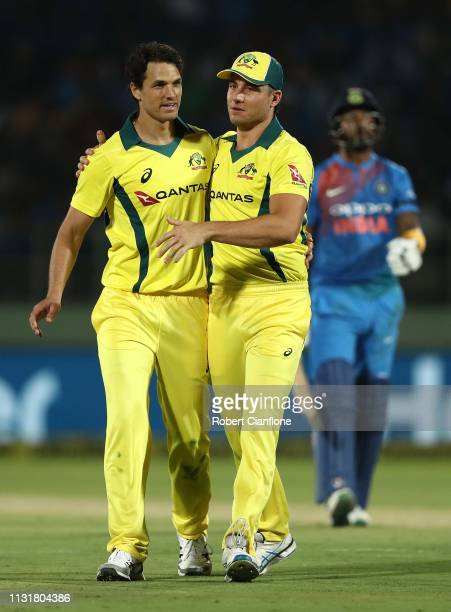 Nathan Coulter-Nile of Australia celebrates with Marcus Stoinis after taking the wicket of Lokesh Rahul of India during game one of the T20I Series...