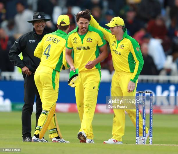 Nathan CoulterNile of Australia the man of the match is congratulated by team mates Steve Smith and Alex Carey after their victory during the Group...
