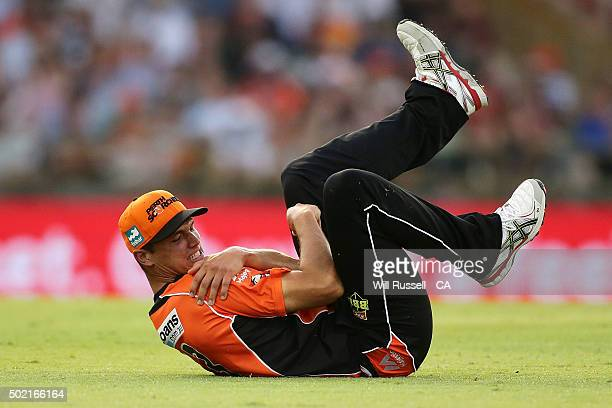 Nathan CoulterNile of the Scorchers grabs his shoulder after sustaining an injury during the Big Bash League match between Perth Scorchers and...