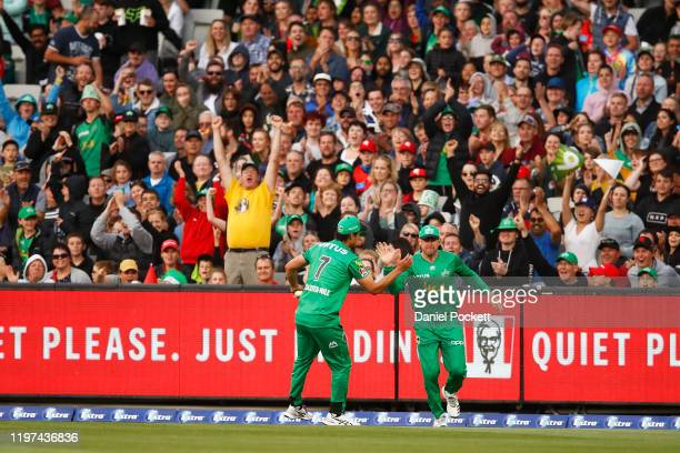 Nathan CoulterNile of the Stars celebrates with Ben Dunk of the Stars after combining to catch out Shaun Marsh of the Renegades during the Big Bash...