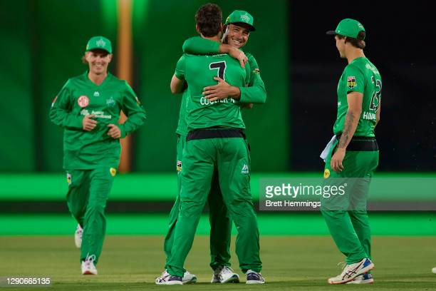 Nathan Coulter-Nile of the Stars celebrates with team mates after taking the wicket of Jack Wood of the Heat during the Big Bash League match between...