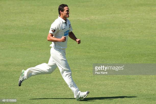 Nathan CoulterNile of the Warriors celebrates the wicket of Peter Handscomb of the Bushrangers during day two of the Sheffield Shield match between...