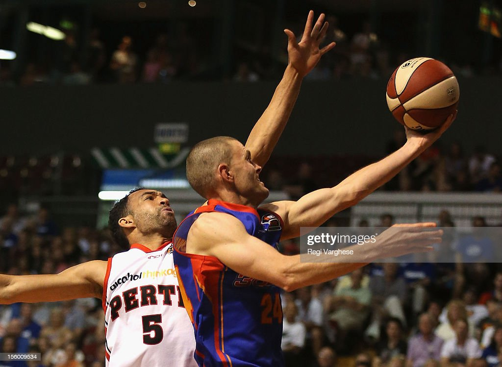 Nathan Crosswell of the 36ers is challenged by Everard Bartlett of the Wildcats during the round six NBL match between the Adelaide 36ers and the Perth Wildcats at Adelaide Arena on November 11, 2012 in Adelaide, Australia.