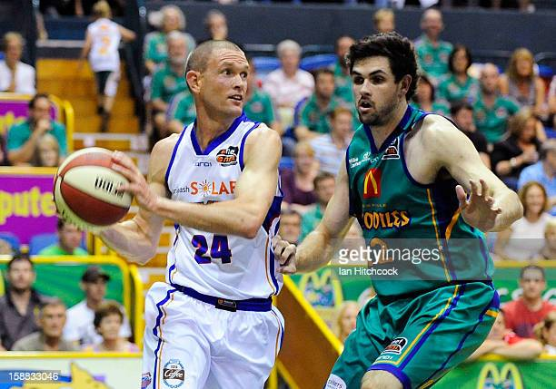 Nathan Crosswell of the 36ers looks to get past Todd Blanchfield of the Crocodiles during the round 12 NBL match between the Townsville Crocodiles...