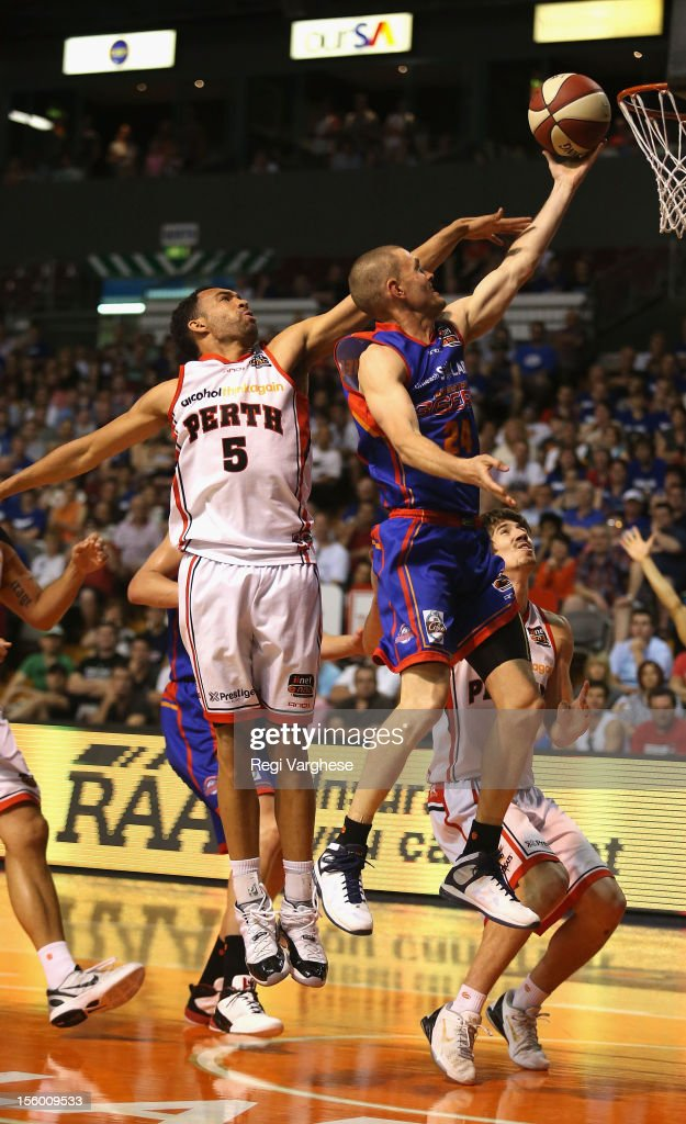 Nathan Crosswell of the 36ers score a point while under pressure from Everard Bartlet of the Wildcats during the round six NBL match between the Adelaide 36ers and the Perth Wildcats at Adelaide Arena on November 11, 2012 in Adelaide, Australia.