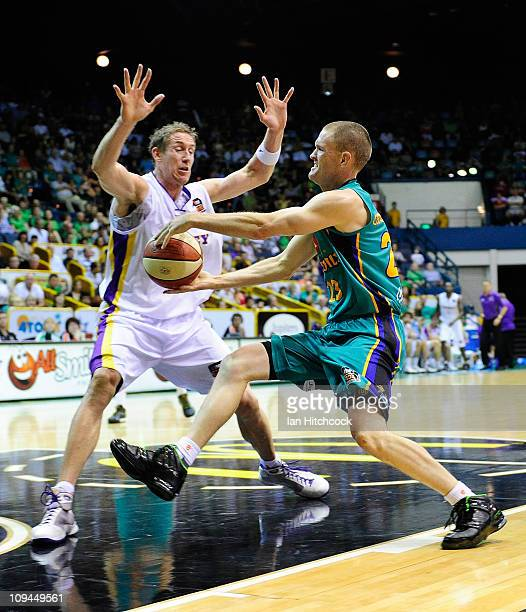 Nathan Crosswell of the Crocodiles attempts to drive past Ben Knight of the Kings during the round 20 NBL match between the Townsville Crocodiles and...