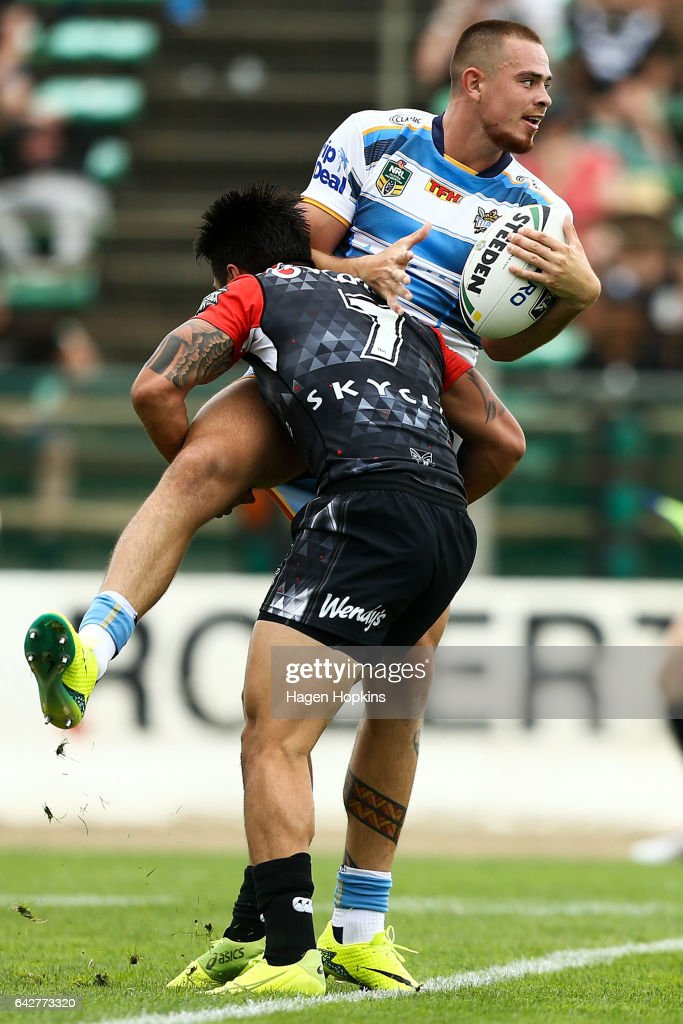 Nathan Davis of the Titans is tackled by Shaun Johnson of the Warriors during the NRL Trial match between the Warriors and the Gold Coast Titans at Central Energy Trust Arena on February 19, 2017 in Palmerston North, New Zealand.