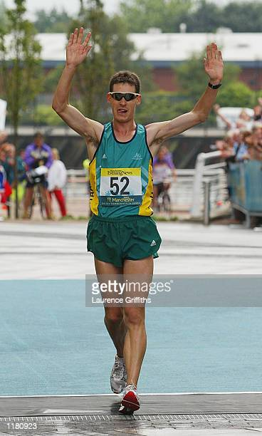 Nathan Deakes of Australia celebrates winning the Mens 50 km walk in Salford Quays in Manchester England on JULY 30 2002