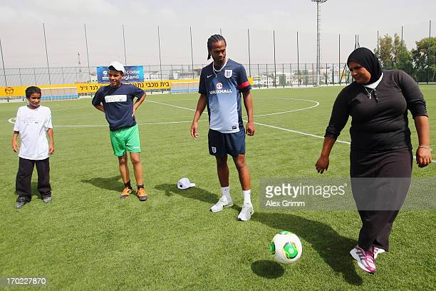 Nathan Delfouneso attends an England training with local school children on June 9 2013 in Netanya Israel