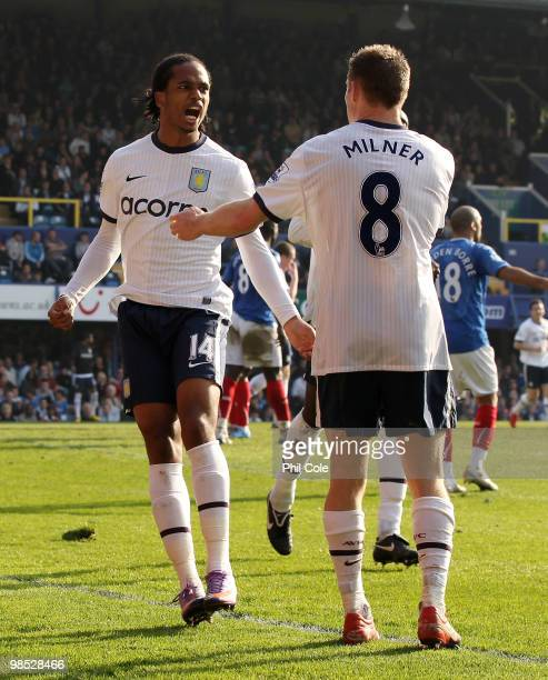 Nathan Delfouneso of Aston Villa celebrates his goal with team mate James Milner during the Barclays Premier League match between Portsmouth and...