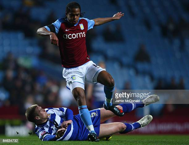 Nathan Delfouneso of Aston Villa is tackled by Matthew Mills of Doncaster Rovers during the FA Cup sponsored by Eon 4th round replay match between...