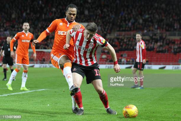 Nathan Delfouneso of Blackpool and Lynden Gooch of Sunderland during the Sky Bet League 1 match between Sunderland and Blackpool at the Stadium Of...