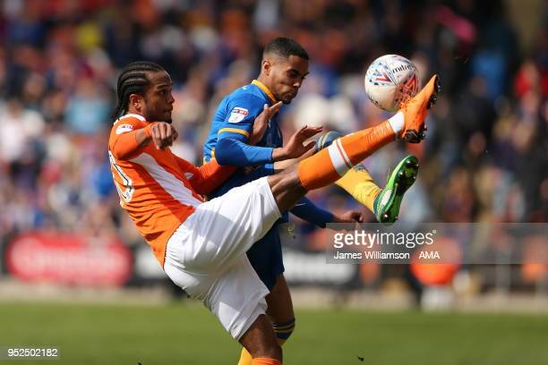 Nathan Delfouneso of Blackpool and Max Lowe of Shrewbury Town during the Sky Bet League One match between Blackpool and Shrewsbury Town at Bloomfield...