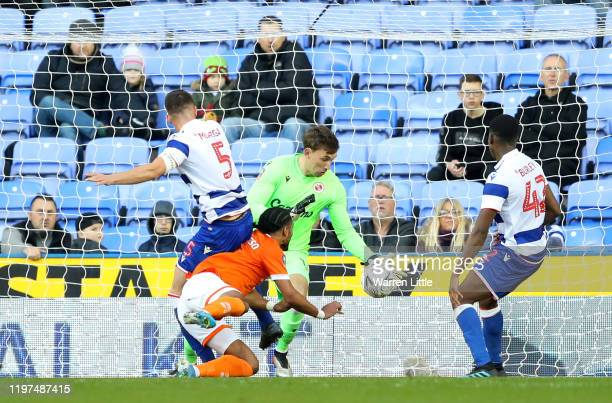 Nathan Delfouneso of Blackpool scores his team's first goal during the FA Cup Third Round match between Reading FC and Blackpool FC at Madejski...
