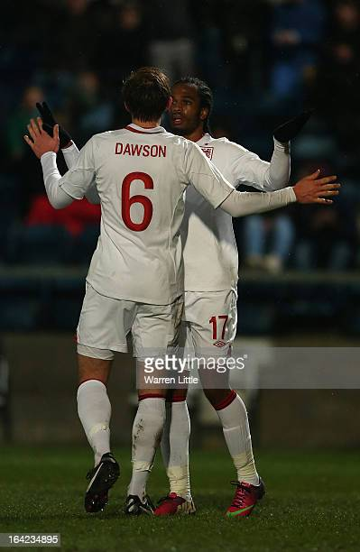 Nathan Delfouneso of England is congratulated by Craig Dawson after scoring a goal during the International match between England U21 and Romania U21...