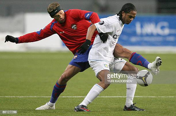 Nathan Delfouneso of England's Aston Villa vies with Aleksei Berezutskiy of Russia's CSKA Moscow during their UEFA Cup second leg football match in...