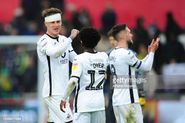 Nathan Dyer and Joe Rodon of Swansea City at full time during the Sky Bet Championship match between Swansea City and West Bromwich Albion at the...