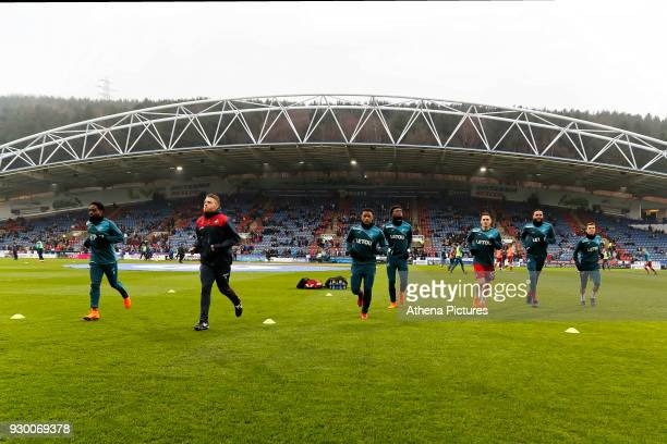 Nathan Dyer coach Eddie Lattimore Luciano Narsingh Tammy Abraham and Connor Roberts of Swansea City warm up prior to the game during the Premier...