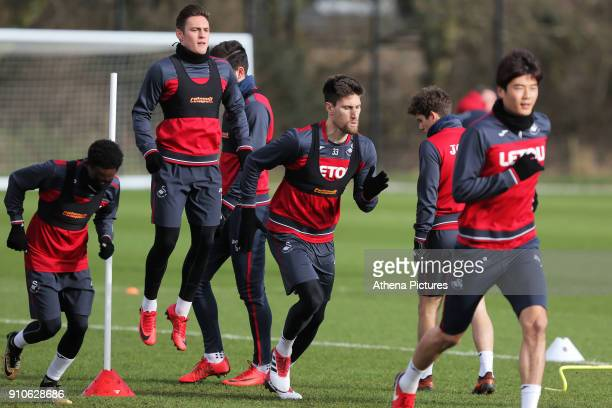 Nathan Dyer Connor Roberts Federico Fernandez and Ki SungYueng in action during the Swansea City Training at The Fairwood Training Ground on January...