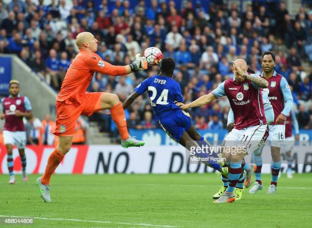 Nathan Dyer of Leicester City beats goalkeeper Brad Guzan of Aston Villa to score their third goal during the Barclays Premier League match between...