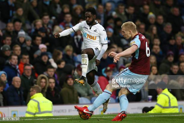 Nathan Dyer of Swansea City and Ben Mee of Burnley compete for the ball during the Premier League match between Burnley and Swansea City at Turf Moor...