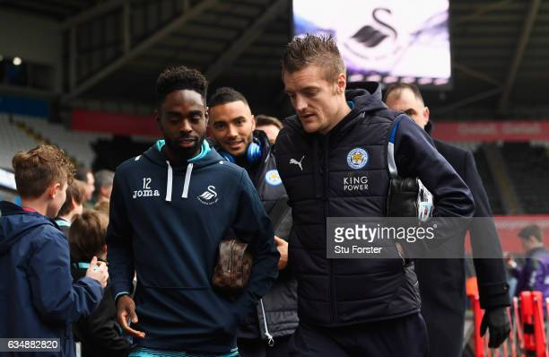 Nathan Dyer of Swansea City and Jamie Vardy of Leicester City in discussion as they arrive prior to the Premier League match between Swansea City and...