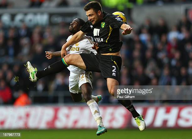 Nathan Dyer of Swansea City battles for the ball with Russell Martin of Norwich City during the Barclays Premier League match between Swansea City...