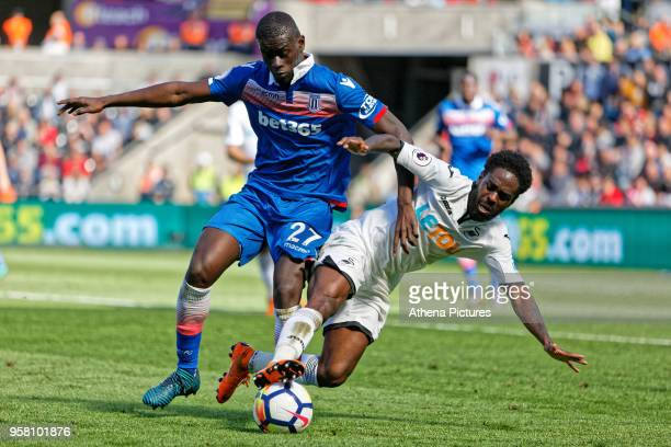 Nathan Dyer of Swansea City brought down by Badou Ndiaye of Stoke City during the Premier League match between Swansea City and Stoke City at The...